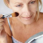 http://www.dreamstime.com/royalty-free-stock-photos-mid-age-woman-applying-make-up-image21013258